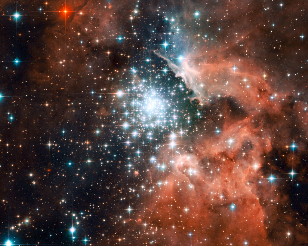 Extreme star cluster bursts into life in new Hubble image